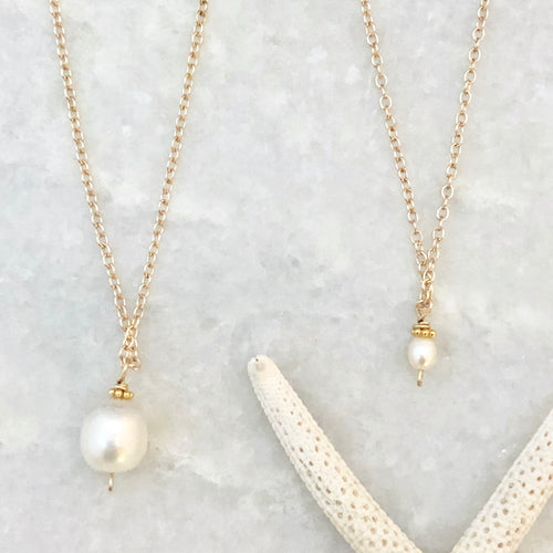 Big & little embellished pearl necklaces