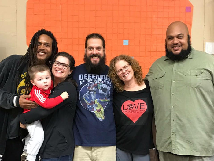 image of Heather and her son with four other people