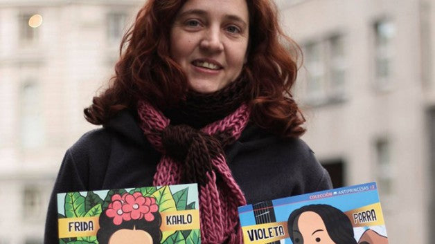 image of  Nadia Fink holding two of her books