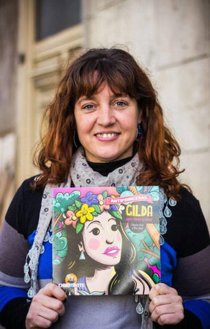 image of  Nadia Fink holding one of her books