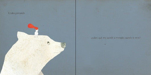 inside page of the book depicting an illustration of a little boy standing over a huge polar bear's head.