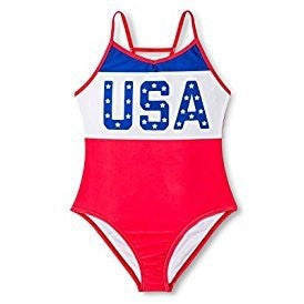 "Girl's one-piece swimsuit with solid red, white, and blue color blocks and says ""USA"" with red racerback straps."