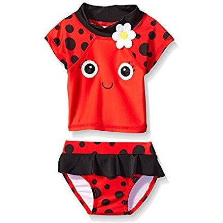 Adorable summer rash-guard or swimsuit set with red and black ladybug theme. Shirt has cute smiley face and daisy, bottoms are red with black waist accent.