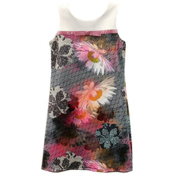 Sleeveless knee-length dress with solid white yoke, gray and black geometric design beneath colorful abstract floral print