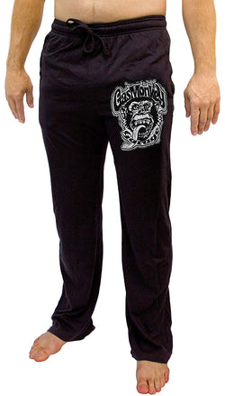 Model wearing black long sleep pajama pants with white Gas Monkey Garage logo on front pocket