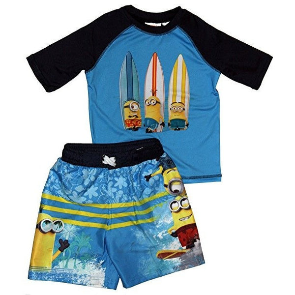Matching boys swim set featuring surfing Minions with half-sleeve black and blue rash guard t-shirt and matching green and blue swim trunks