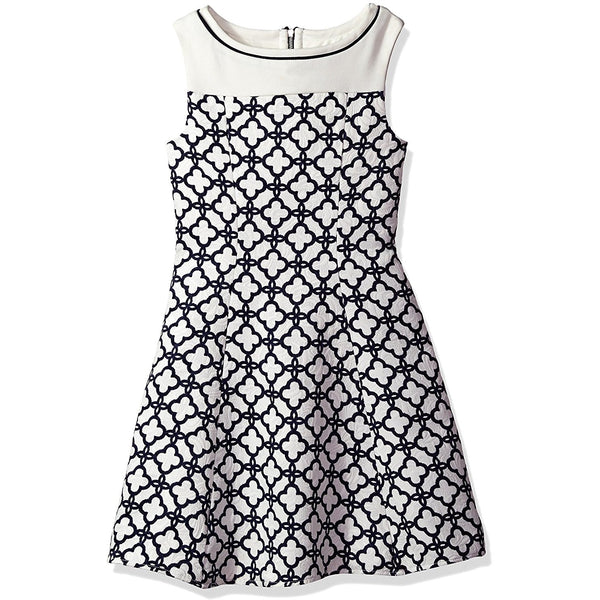 White and navy blue cloverleaf patterned knee-length sleeveless dress with solid white yoke and navy contrast piping