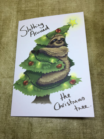 Slothing around the Christmas Tree Blank Greeting Card