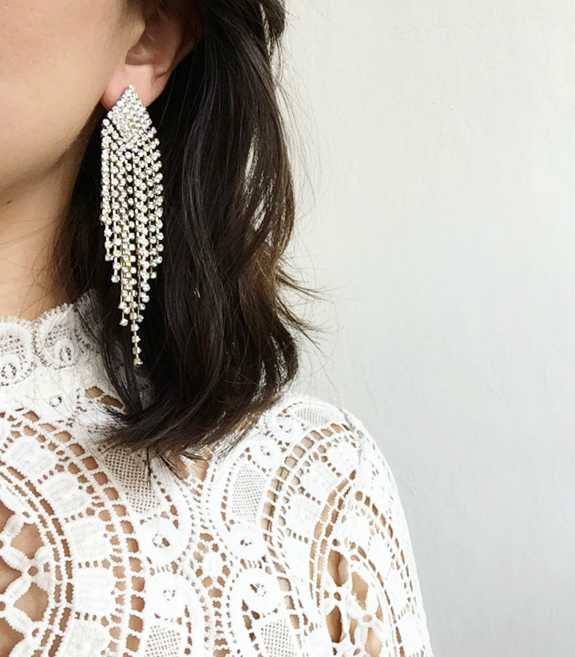 Glamorous statement rhinestone fringe earrings.