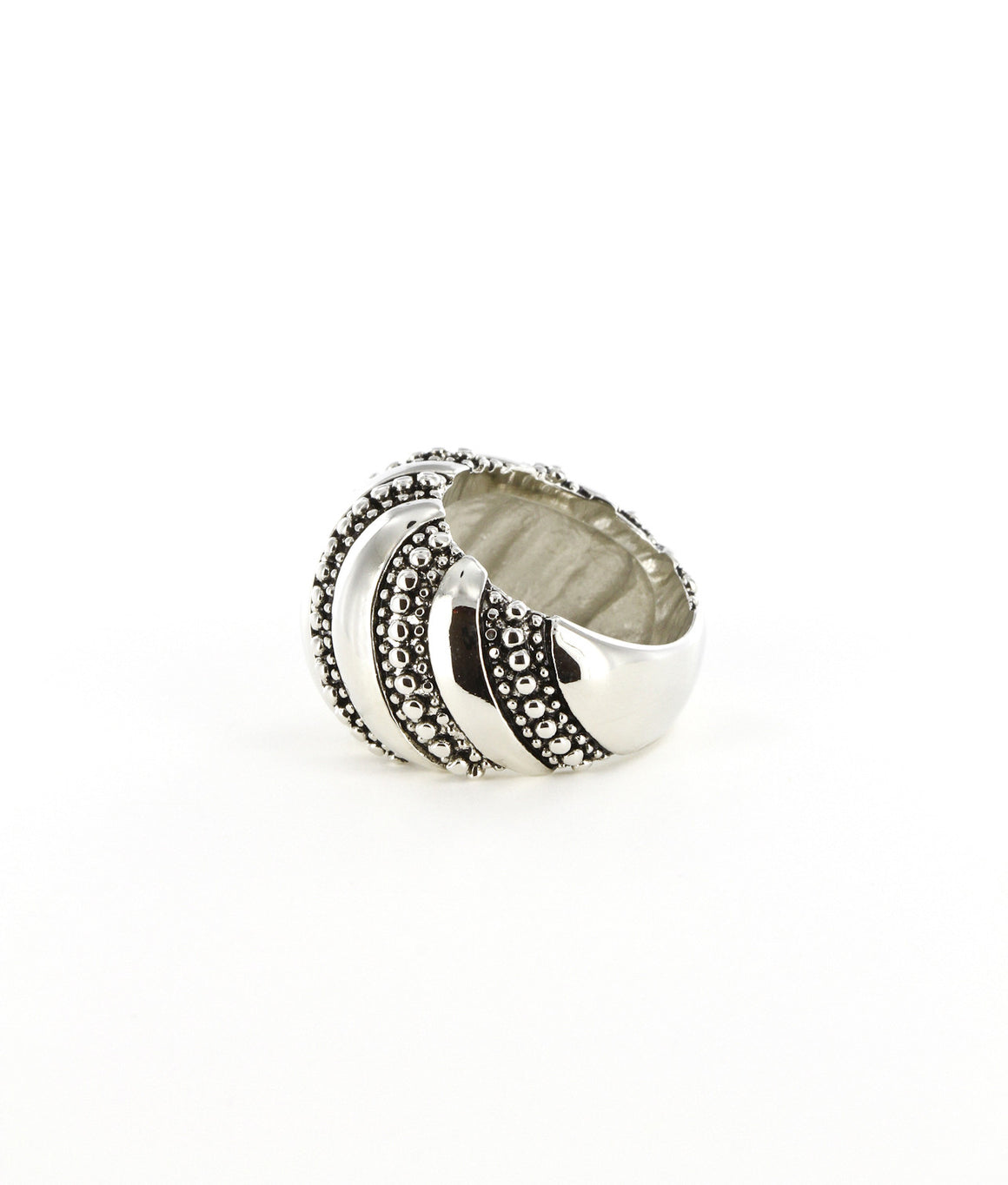 Stripe and dappled polished dome ring.