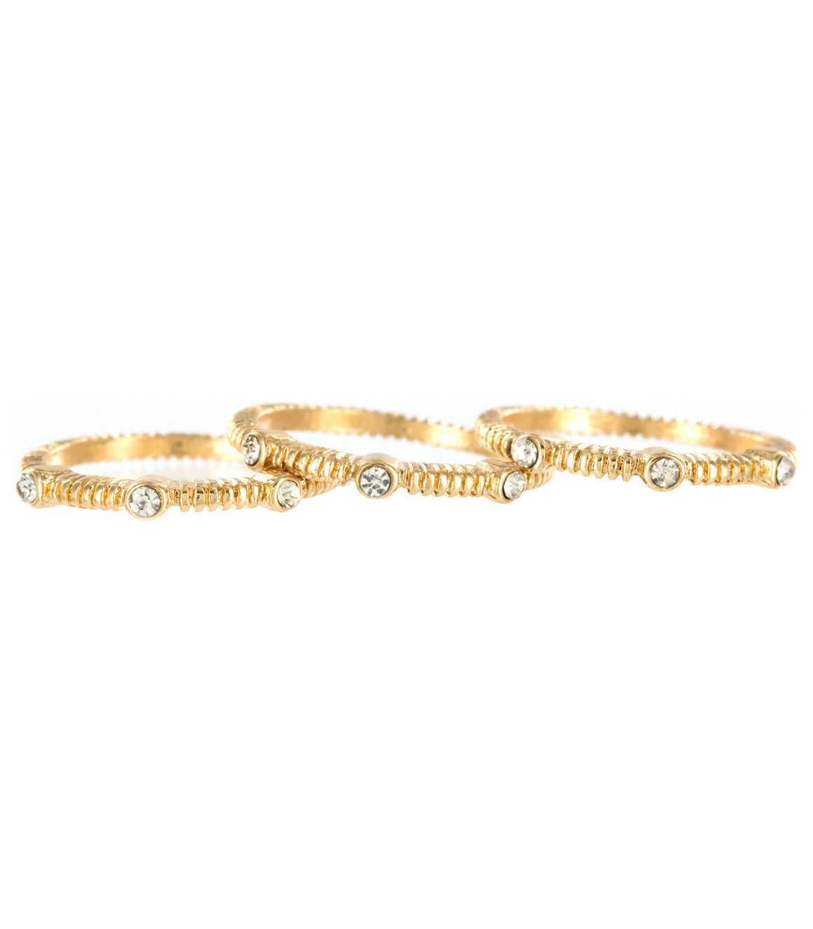 Minimalist delicate gold stacking rings.