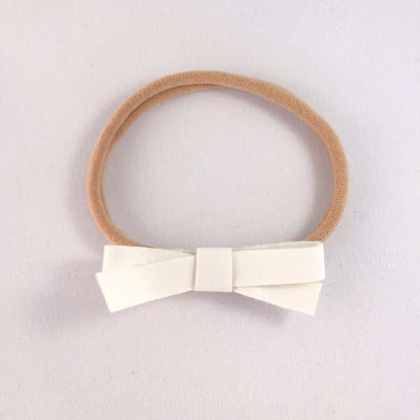 Audrey White Leatherette Bow Headband