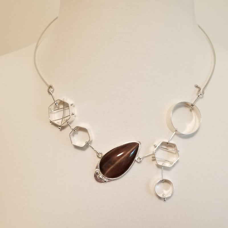 Geometric bib necklace with red tiger eye