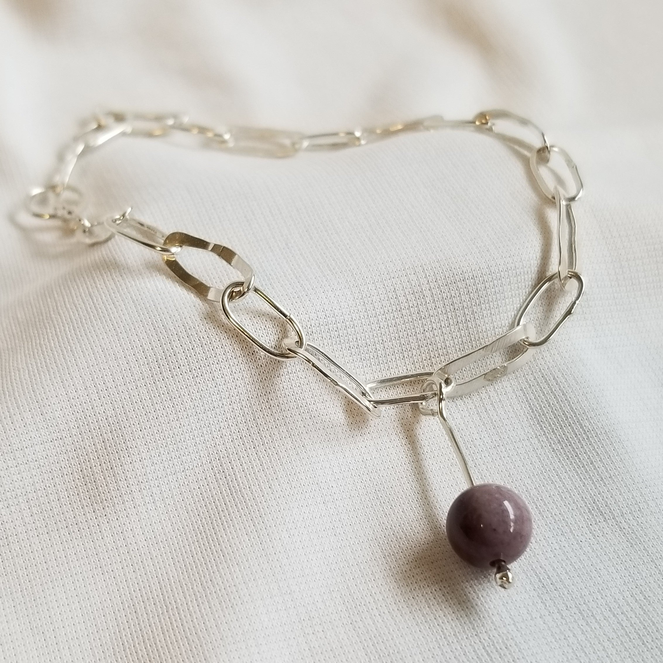 Link bracelet with purple mookaite jasper drop