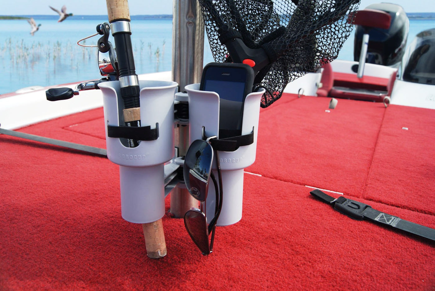 ROBOCUP is patented clamp on cup holder for fishing boat