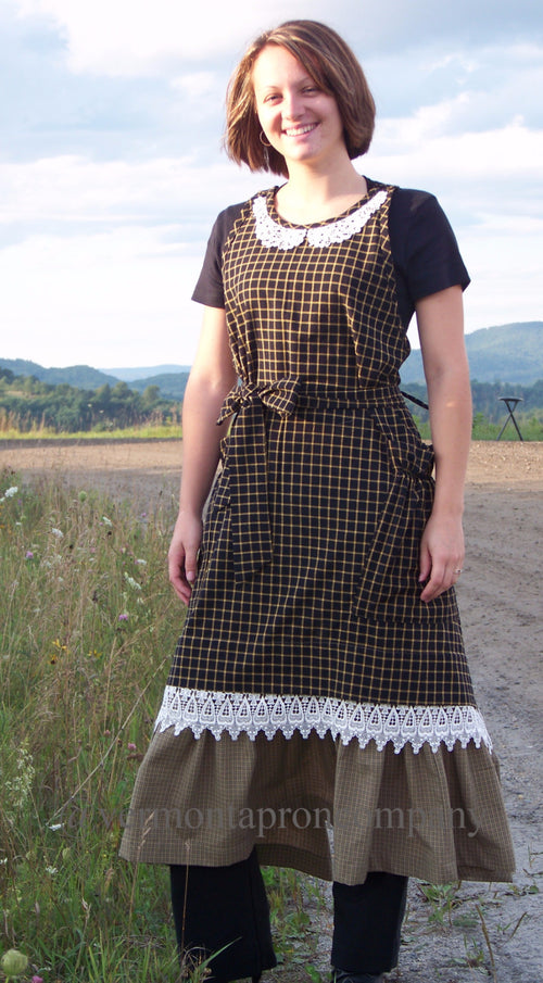 Country Hostess Apron in Black Homespun - by The Vermont Apron Company is paired with lace trim over a wide ruffled bottom.