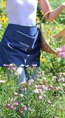 Pouch Apron in Navy Denim, front/ side view