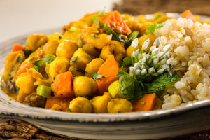 Chickpeas simmered in rich  fragrant Mediterranean herbs and spices  served with millet/brown rice.