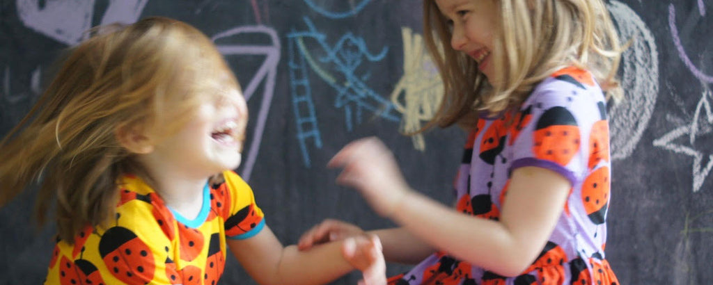 Colourful Scandi kids in ladybird dresses by DUNS Sweden