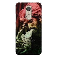 Portrait of a man with an intense look, smoking a cigar  Lenovo k6 note hard plastic printed back cover