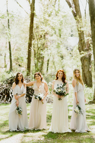 Bridesmaids and bride in a forest
