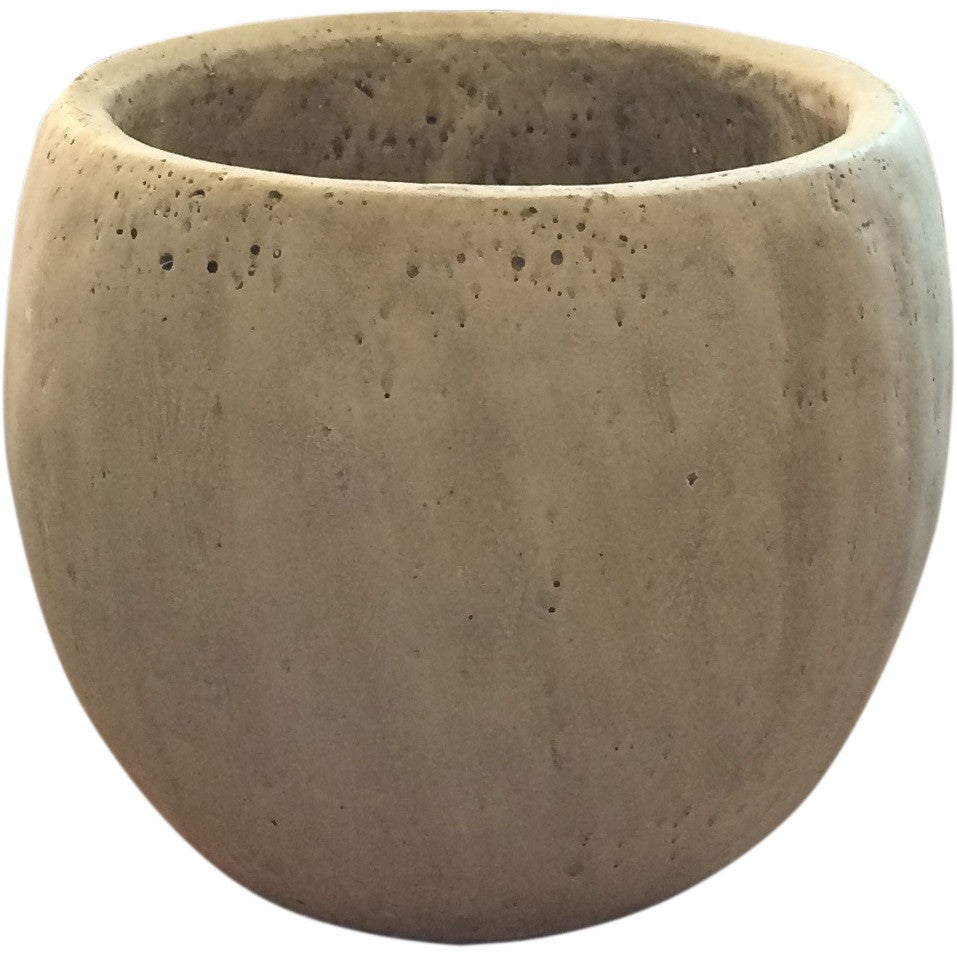 An earthy, organic, concrete vessel to be filled with flowers in the color palette of your choice.