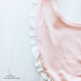 Pink white frilled bib