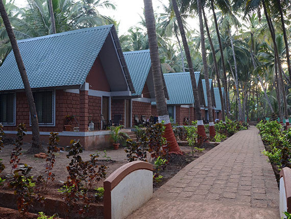 Ladghar Beach : Stay in AC premium cottages at Blue Breeze Resort.