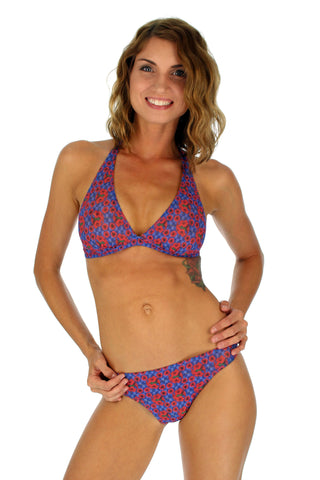 Tan through halter bikini in blue Hibiscus print.