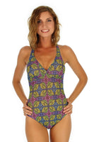 Cameo modeling green Heat tan through adjustable criss cross strap swimsuit from Lifestyles Direct.