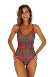 Front of green Hibiscus crisscross adjustable strap swimsuit.