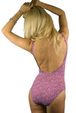 Back view of purple Flower Power tan through womens swimsuits with underwires and adjustable straps.