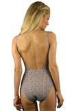 Back view of underwire support adjustable strap tank swimsuit in Tiny Flower print.