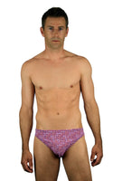 Tan through mens swimsuit with 1 inch sides and purple Flower Power print.