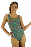 Tan through tank swimsuit in green Forever print.