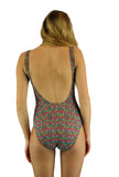 Back view of tan through traditional tank swimsuit in pink Toucan print.
