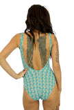 Back view of tan through C-D underwire womens swimsuit with Conch print.