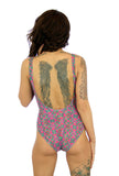 Nicole modeling back of Kaleidoscope underwire support swimsuit with C-D cups.