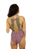 Back view of crisscross adjustable strap swimwear for women in Kaleidoscope print.