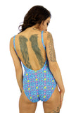Back view of blue Bubbles tan through underwire support womens swimsuit with adjustable straps.