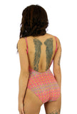 Tan through womens swimsuit with adjustable straps and underwire cups in pink Forever print.