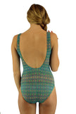 Green Forever tan through womens swimsuits with structured cups -- back view.