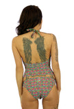 Back view of tan through high waisted bikini bottom -- pink Toucan print.