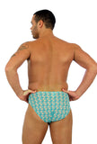 "Back view of Lifestyles Direct Tan Through Swimwear for men -- 1"" racer in Conch print."