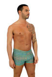 Mens bike short in green Forever tan through mens swimwear.