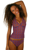Jordan modeling tan through swimsuit bottom with high waist in blue Hibiscus print.
