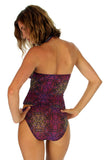 Back view of tan through high waisted bikini bottoms in purple Safari print.