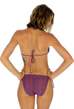 Double tie string bikini bottoms -- blue Hibiscus -- tan through swimwear.