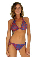 String bikini top tan through swimsuit in blue Hibiscus.