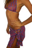 Tan through sarong from Lifestyles Direct in blue Hibiscus.